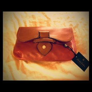 Soft leather two tone clutch. Never used.